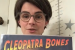 Chloe Smith MP Holding Cleopatra Bones Book